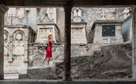 A young woman visits the town's old cemetery on July 30, 2006 in Sibenik, Croatia. Stock Photo - 17298373