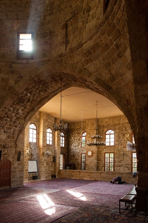 Sidon, Lebanon - January 3, 2006: A man prays in a old mosque