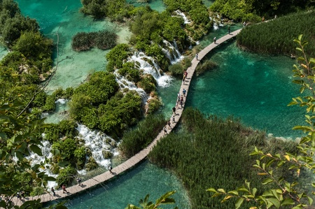 Tourists walk on a path on July 25, 2006 in Plitvice Lakes National Park, Croatia.