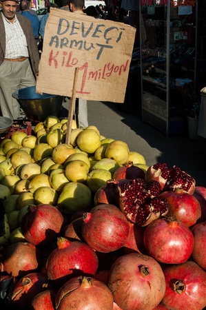 Istanbul, Turkey - October 21, 2005: An unidentified man sells fresh fruits in Fatih Market. Since the Fatih district is located in the historical part of Istanbul, it offers the oldest and also the biggest market place of the city.