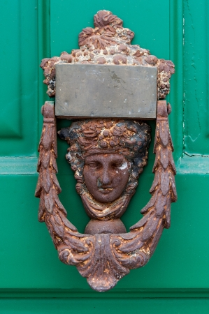 Old knocker on green door in Greece photo