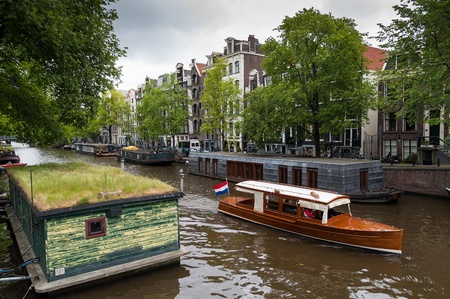 Traditional houseboats in Amsterdam Stock Photo - 17362873