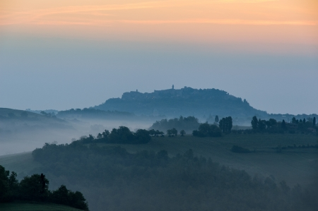 Typical Tuscan landscape in morning mist photo