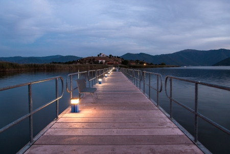 Floating bridge at sunset in Mikri Prespa Lake, Greece photo