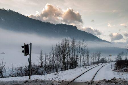 On the road, winter landscape near Austrian Alps