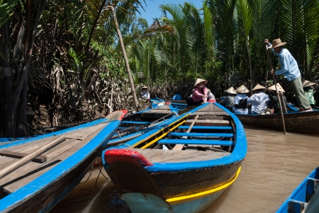 Mekong Delta, Vietnam - February 15, 2007: Villagers travel by taxi-boat. Редакционное