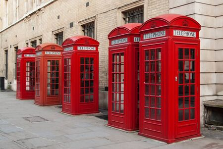 Traditional red telephone boxes in London, UK photo