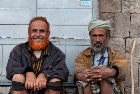 suq: Sanaa, Yemen - May 4, 2007: Two men pose in front of a store. Among other arabic countries, in 2012 Yemen became a site of civil conflicts.