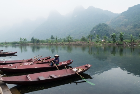 Red River Delta, Vietnam - January 19, 2008: An unidentified local woman sits in her �taxi�-boat while waiting for tourists. The Red River Delta is the cradle of the Vietnamese nation.