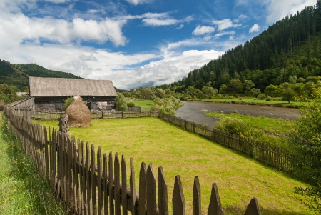 Traditional wooden farmhouse in Transylvania, Romania photo