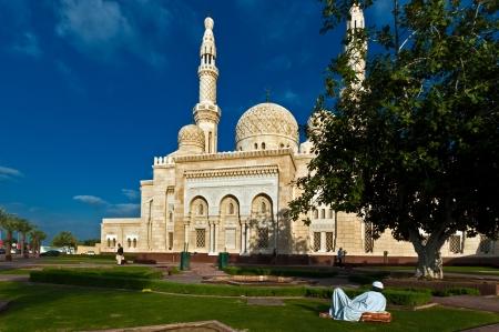 Dubai, UAE - January 1, 2005: An unidentified  pilgrim rests outside the Jumeirah Mosque, the largest mosque of Dubai.