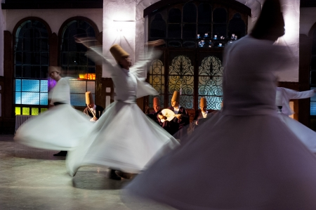 whirling: Istanbul, Turkey - October 21, 2005: Whirling dervishes and musicians perform to visitors in the event hall of Sirkeci Train Station, the old terminus of the Orient Express.