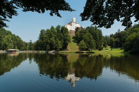 Croatia - July 23, 2006: The 13th century Trakoscan Castle and its lake in northern Croatia