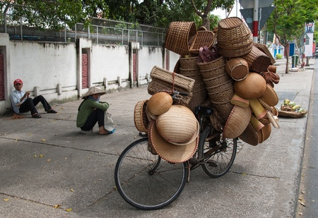 An unidentified woman sells baskets on January 2, 2008 in Ho Chi Minh City, Vietnam. Street vending by bicycle, bike or on foot is an essential part of city life in Vietnam. Редакционное