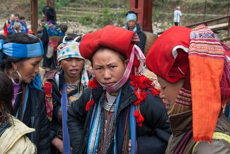 A group of unidentified women wait in the market on January 18, 2008 in Sapa, Vietnam. Sapa, a popular destination for tourists, is home to a great diversity of ethnic minorities.