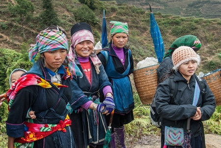 A group of unidentified women pose for tourists on January 18, 2008 in Sapa, Vietnam. Sapa, a popular destination for tourists, is home to a great diversity of ethnic minorities.