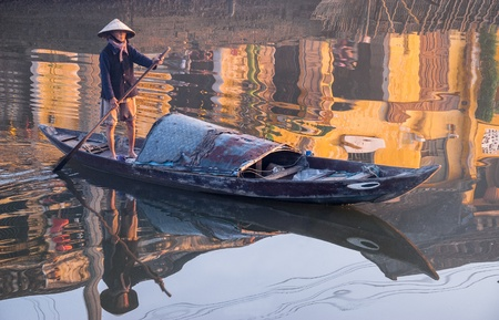 An unidentified fisherman plies the oar in his boat on January 10, 2008 in in the harbor of Hoi An, Vietnam. Hoi An, a UNESCO World Heritage site, is a major touristic destination in Central Vietnam. Editorial