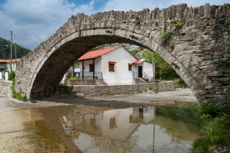 Old stone bridge in a traditional village of Macedonia, Greece