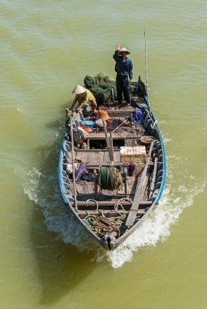 An unidentified fisherman greets with a wave as he crosses the river with his boat on January 8, 2008 in  Mekong Delta, Vietnam. Recently, over 10.000 new species have been discovered here in previously unexplored areas.