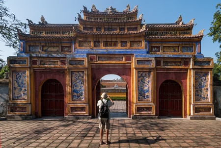 An unidentified tourist takes a picture of the Gateway of Dien Tho in the protected by UNESCO old imperial city on January 11, 2008 in Hue, Vietnam. Although seriously damaged during the war, its historic monuments earned the city a place in UNESCO