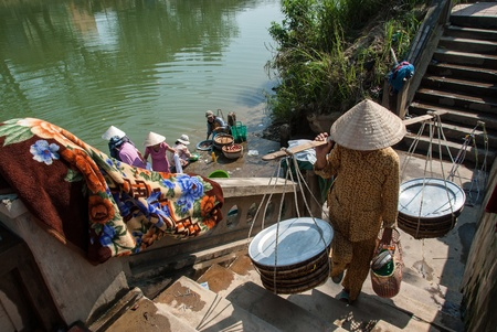 A group of unidentified women do their laundry in the Perfume River on January 12, 2008 in Hue, Vietnam.