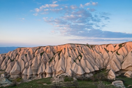 goreme: Typical landscape with sandstone formations in Cappadocia, Turkey, at sunset