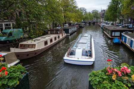 Traditional houseboats in Amsterdam, Netherlands Stock Photo