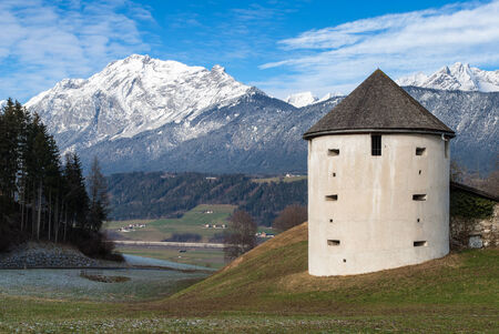 Old tower and part of the Austrian Alps in winter