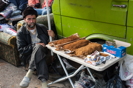 suq: An unidentified man sells blended tobacco in the main open market of the city on January 1, 2006 in Tripoli, Lebanon