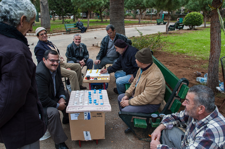beirut lebanon: A group of unidentified men play board games in one of the city parks on December 29, 2005 in Beirut, Lebanon  Editorial