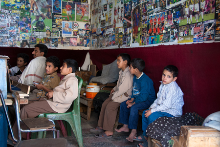 socially: A group of unidentified boys play video games in a local cafe on May 4, 2007 in Sanaa, Yemen. Although infant mortality is high, children in Yemen are culturally, socially and religiously valued.