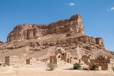 Part of the city of Al Hajarayn in a landscape with rock formations in Yemen