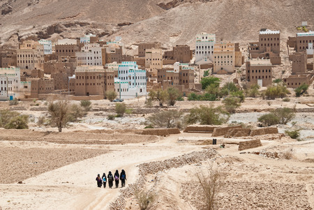 socially: A group of unidentified girls in black clothes return home after school on May 8, 2007 in Al Hajarayn, Yemen.  Although infant mortality is high, children in Yemen are culturally, socially and religiously valued.