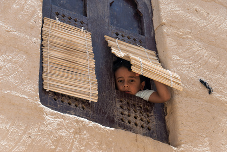 socially: An unidentified boy looks at the camera through his window on May 8, 2007 in Al Hajarayn, Yemen. Although infant mortality is high, children in Yemen are culturally, socially and religiously valued. Editorial