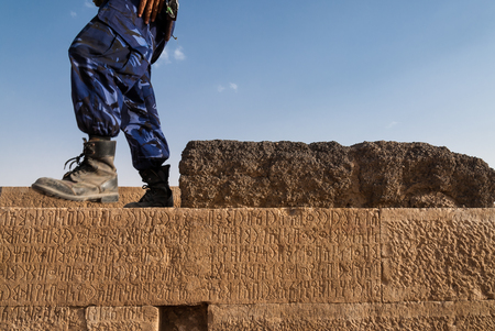 An unidentified policeman guards an archaeological site on May 6, 2007 in Marib, Yemen. Among other arabic countries, in 2012 Yemen became a site of civil conflicts, which still continue.