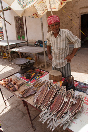 suq: An unidentified man sells dried fish in the market of the city on May 9, 2007 in Tarim, Yemen. Due to the rich with fish species Red Sea, fish markets play a central role in the economic life of Yemen.