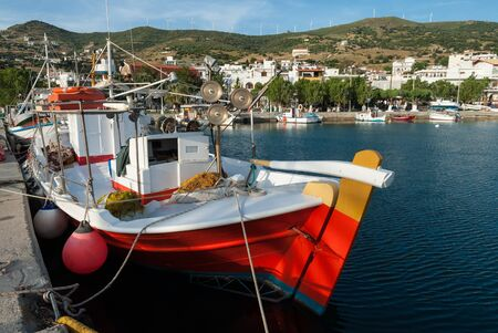 Traditional fishing boats in a port of Euboea island, Greece Stock Photo