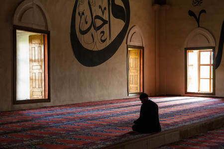 selimiye mosque: An unidentified man prays in one of the central mosques of the city on May 5, 2015 in Edirne, Turkey. Apart from the famous Selimiye Mosque, the masterpiece of Mimar Sinan, in Edirne there are several important mosques of high architectural value.