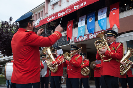 brass  band: A military brass band plays music on May 6, 2014 in the streets of Edirne, Turkey. Turkish marching bands have had a strong influence on the balkan music.