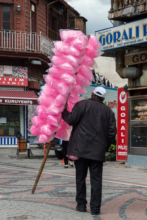 edirne: An unidentified man sells pink sweets for the children on May 6, 2014 in the streets of Edirne, Turkey. Seldom visited by tourists, Edirne is a pleasant historic city, full of monuments.