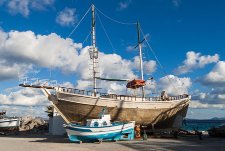 kos: Traditional wooden fishing boat and ship in Kos island, Greece Stock Photo