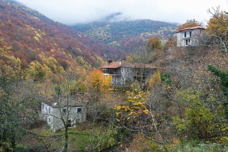 greece: Autumnal landscape with old traditional stone houses in Skotina village, near Mount Olympus in Greece