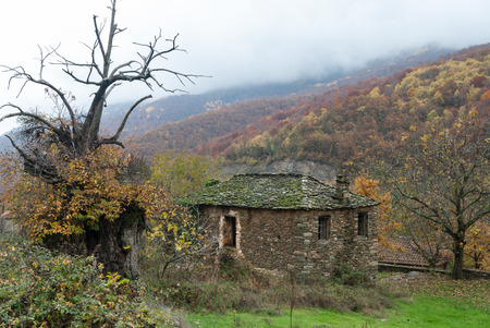 olympus: Autumnal landscape with old traditional stone house in Skotina village, near Mount Olympus in Greece