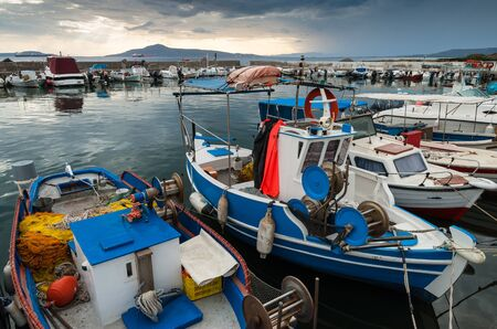 laconia: Traditional wooden fishing boats in the harbor of Neapoli in Peloponnese, Greece Stock Photo