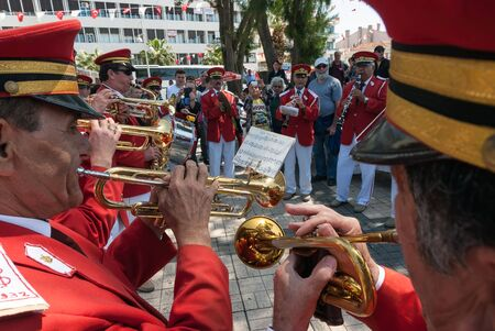 brass  band: A military brass band plays music on April 22, 2014 in the streets of Ayvalik, Turkey. Turkish marching bands have had a strong influence on balkan music.