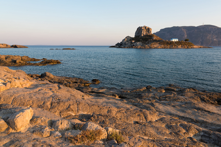 islet: Landscape with rocky coastline and islet at sunset in Kos island, Greece Stock Photo