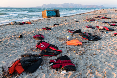 savers: Abandoned life savers of refugees on October 6, 2015 on a beach of Kos island, Greece. Thousands of Syrian refugees have passed from Turkey to Greek islands since the summer of 2015. Editorial