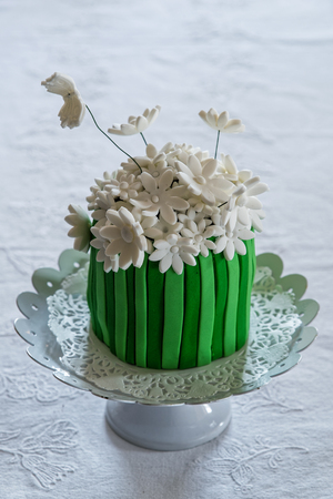 homemade cake: Small homemade cake, decorated with white flowers