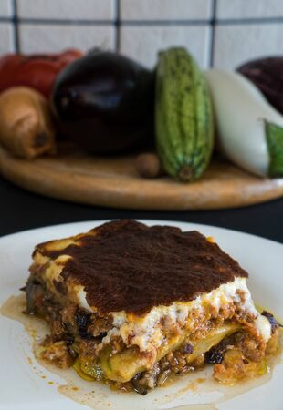Plate of homemade moussaka with various eggplants and other vegetables