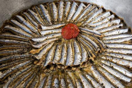 sardines: Cooked sardines in pan